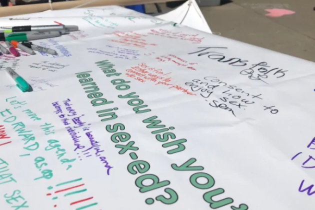 Banner where people wrote what they wish they'd learned in sex-ed