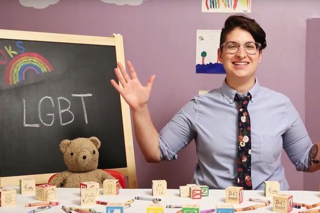 Image of an educator in front of a blackboard that says LGBT