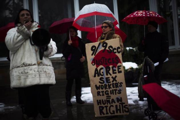 Protestors are seen during rally at Allan Gardens in Toronto. . THE CANADIAN PRESS/Mark Blinch