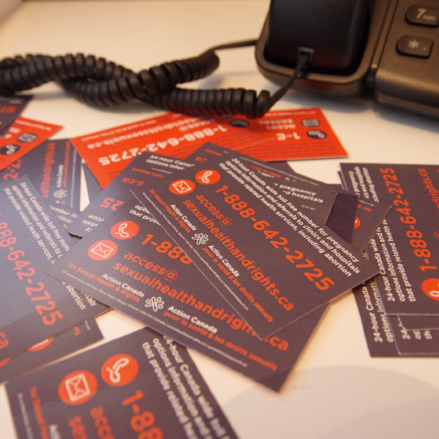 Access Line Business Cards next to a phone